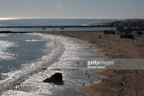 People are seen along Corona del Mar State Beach on April 15 2020 in Newport Beach California Southern California has seen warmer weather over the...