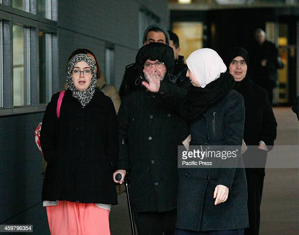 People are seen arriving and leaving the court where seven young men are being accused of recruiting young Muslims to take part in the Jihad in Syria...