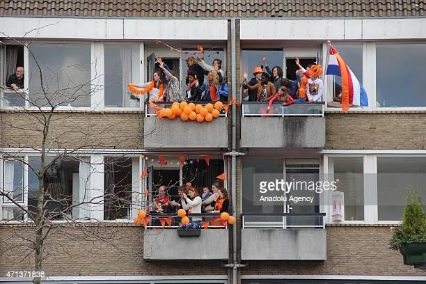 People are seen as Dutch Queen Maxima and King Willem-Alexander greet the public during King's Day celebrations on occasion of the birthday of the...