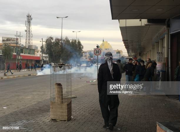 People are seen as protesters clash with security forces during the antigovernment protests in Sulaymaniyah in Sulaymaniyah Iraq on December 19 2017