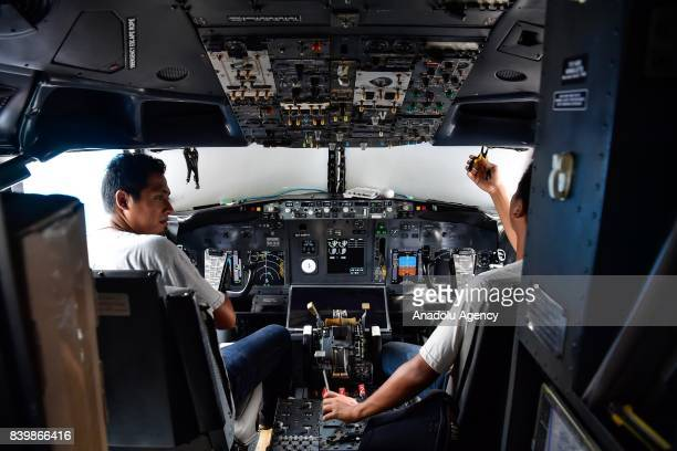 People are seen at a cockpit of a Boeing 737 which is used for a restaurant at Guanggu Walking Street in Wuhan of Hubei Province China on August 27...