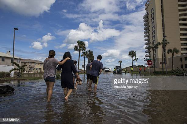 People are seen at a flooded street after Hurricane Matthew passed along Jacksonville Florida USA on October 8 2016