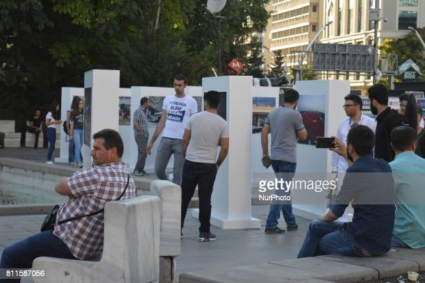 People are seen at a photography exhibition to the 1st anniversary of Turkey's failed coup attempt in Ankara Turkey on July 09 as the exhibition is...
