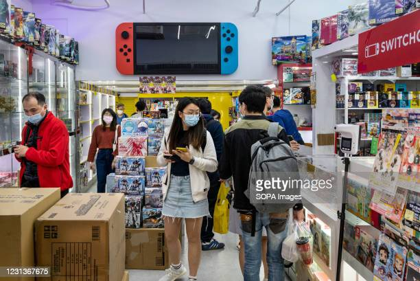 People are seen at a store selling Japanese multinational video gaming brand, Nintendo Switch products in Hong Kong.