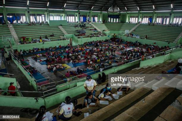 KLUNGKUNG BALI INDONESIA SEPTEMBER 25 People are seen at evacuation center on September 25 2017 in Klungkung regency Island of Bali Indonesia...