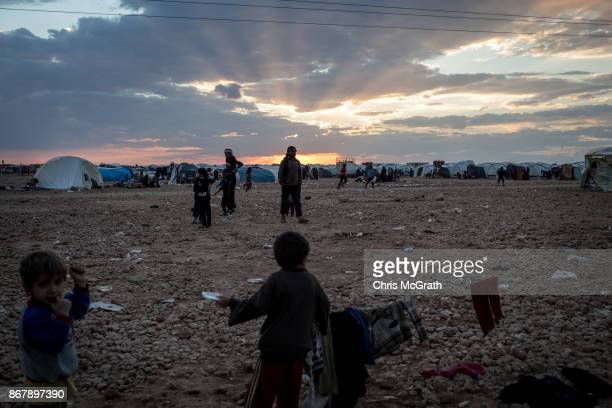 People are seen at sunset at a camp for internally displaced people on October 29 2017 in Ain Issa Syria Following three and a half months of...