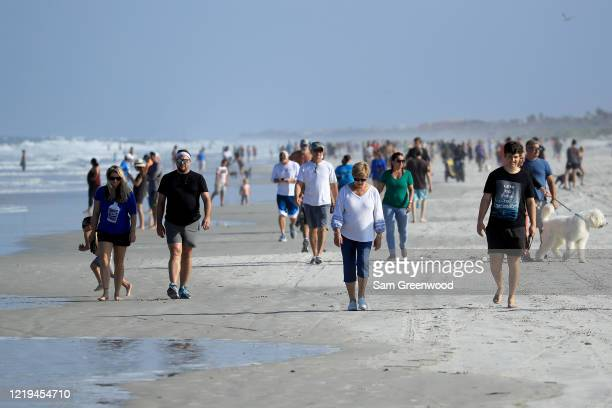 People are seen at the beach on April 17, 2020 in Jacksonville Beach, Florida. Jacksonville Mayor Lenny Curry announced Thursday that Duval County's...