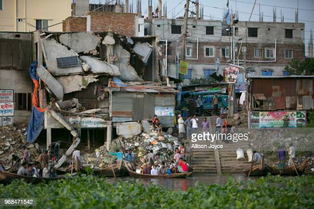 People are seen at the Buriganga river on June 5 2018 in Dhaka Bangladesh Bangladesh has been reportedly ranked 10th out of the top 20 plastic...