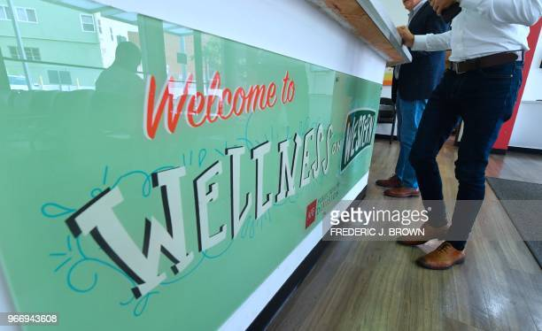 People are seen at the counter of the the AIDS Healthcare Foundation Wellness Center which offers blood and urinie testing in Hollywood California on...
