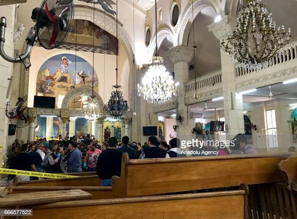 People are seen at the damaged Saint George church after a bombing struck inside the church in the Nile Delta city of Tanta Egypt on April 9 2017 At...