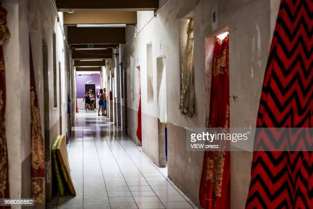 MEXICALI MEXICO July 10 People are seen at the end of the hallway of Hotel del Migrante on July 10 2018 in Mexicali Mexico Hotel del Migrante is a...