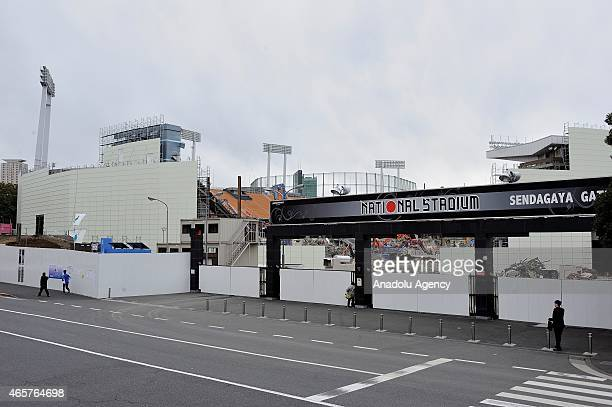 People are seen at the entrance of the National Stadium in Tokyo Japan on March 10 2015 The old National olympic stadium of Tokyo Sendagaya district...