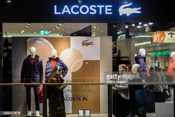 ec5502e581cb People are seen at the Lacoste shop