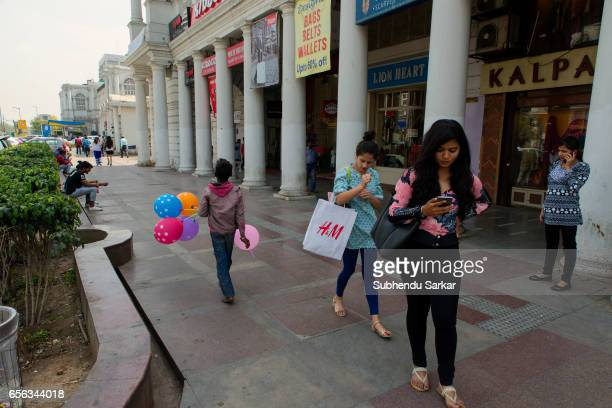 People are seen at the shopping district of Connaught place Connaught place is the main financial and business center of New Delhi which was...