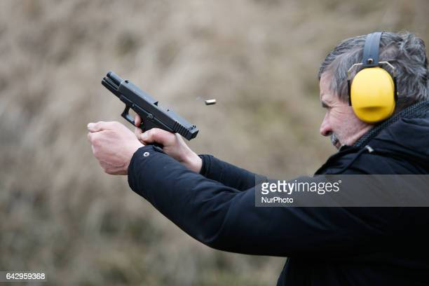 People are seen attending a Shooting Picnic an open day at the firing range on 19 February 2017