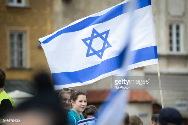 People are seen attending the March of Life Holocaust commemoration on Castle Square in Warsaw Poland on April 15 2018 This year marks the 70th...