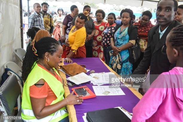 People are seen being registered for Huduma Namba Kenyas National Integrated Identity Management System in Nakuru Town The government says that the...