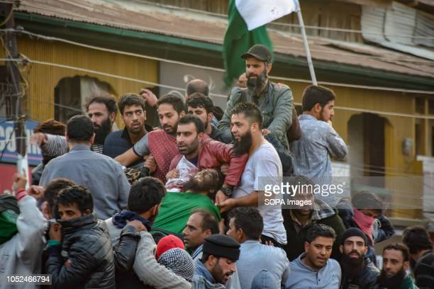 SRINAGAR JAMMU KASHMIR INDIA People are seen carrying dead bodies of a Rebel Mehrajuddin and Civilian Ahmed during their funeral procession Funeral...