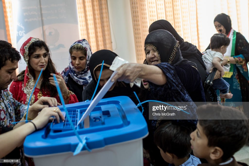 People are seen casting their referendum vote at a voting station on September 25, 2017 in Erbil, Iraq. Despite strong objection from neighboring countries and the Iraqi government. Some five million Kurds took to the polls today across three provinces in the historic independence referendum.