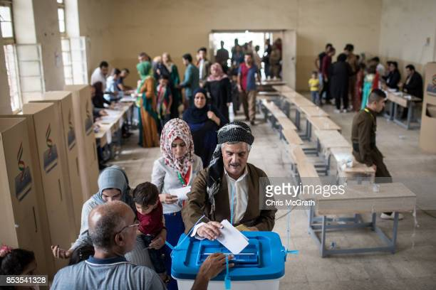 People are seen casting their referendum vote at a voting station on September 25, 2017 in Kirkuk, Iraq. Despite strong objection from neighboring...