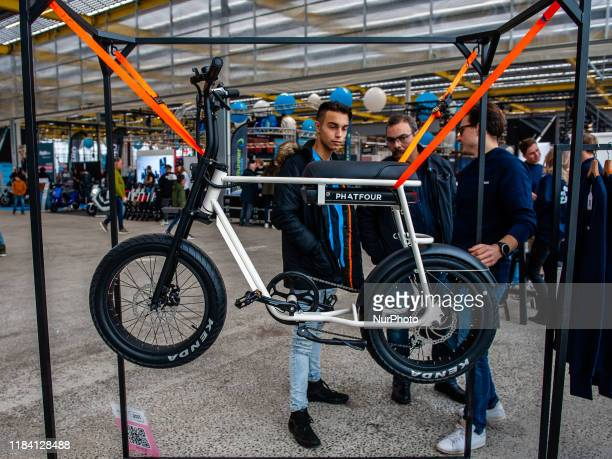 People are seen checking some electric vehicles during the Bright Day Festival in Amsterdam on November 23rd 2019