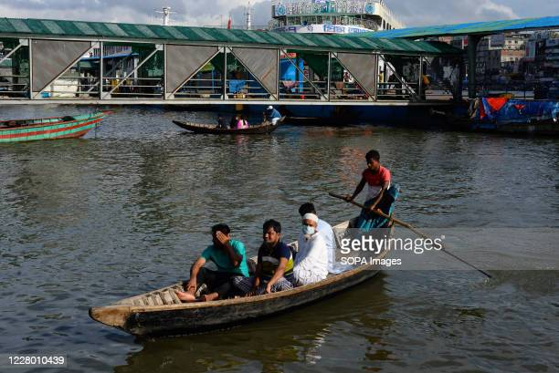 People are seen crossing the Buriganga river by boat in Dhaka. After months of the ongoing pandemic, Dhaka is getting back to its normal life.