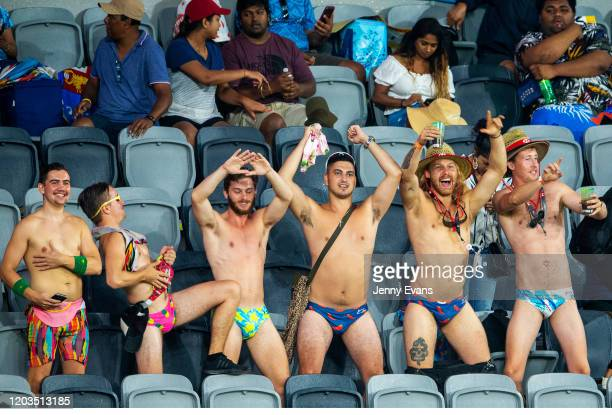 People are seen dancing in the rain as play is delayed due to weather conditions at the 2020 Sydney Sevens at Bankwest Stadium on February 02, 2020...