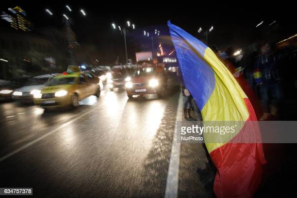 People are seen demonstrating in front of government headquarters on 10 February 2017 Romanians have taken to mass protests across the country for...