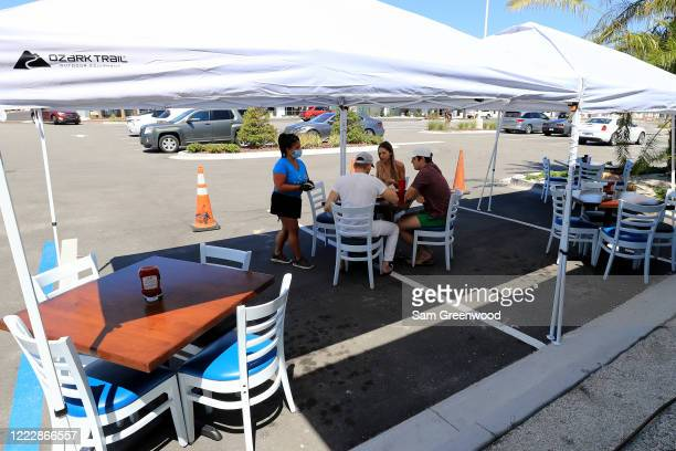 People are seen dining outside at Cruisers Grill as the state of Florida enters phase one of the plan to reopen the state on May 04 2020 in...