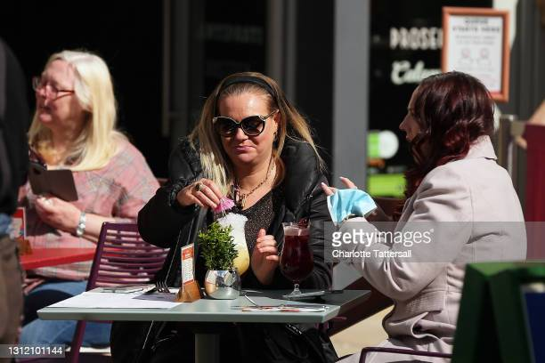 People are seen drinking in outdoor beer gardens on April 12, 2021 in Manchester, England. England has taken a significant step in easing its...