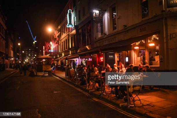 People are seen drinking outside pubs in Soho, ahead of London being moved into Tier 3 of the pandemic-control system on Wednesday, on December 15,...