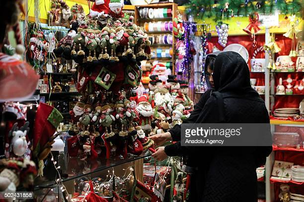 People are seen during a shopping at Mirzayeh Shirazi district where mostly Armenian people live in Tehran Iran on December 24 2015