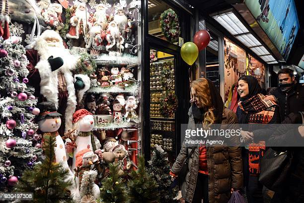 People are seen during Christmas preparation and shopping at the traditional Christmas market where mostly Armenian people live in Tehran Iran on...