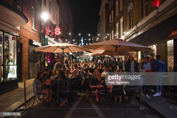 People are seen eating at outdoor restaurants on September 12, 2020 in London, England. From Monday, September 14, groups of more than six will be...