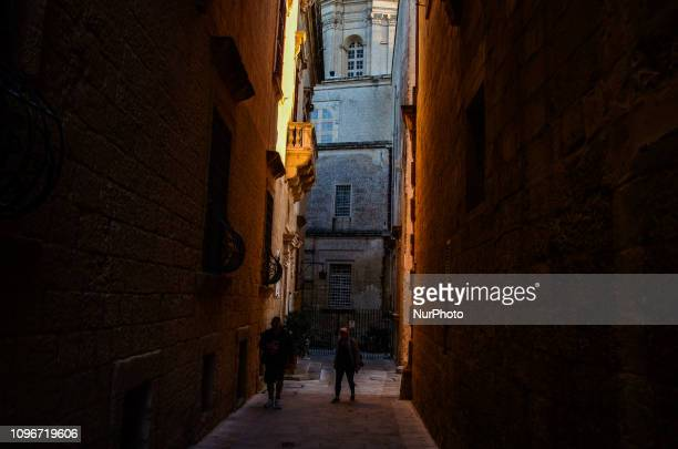 People are seen enjoiyng the good weather and the beautiful sunset over Mdina Malta on February 09 2019