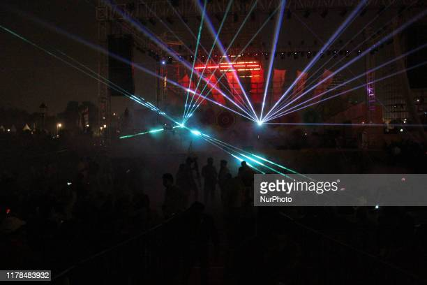 People are seen enjoying a musical performance during an event titled 'Dilli Ki Diwali' at Connaught Place in New Delhi on October 26 2019 The Mega...