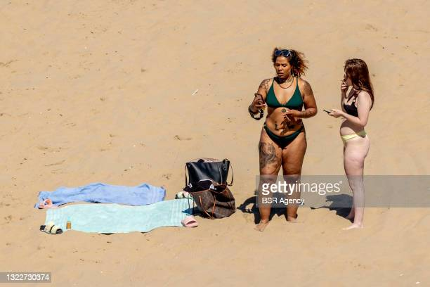 People are seen enjoying the sunny weather at Scheveningen Beach on June 9, 2021 in The Hague, Netherlands. High temperatures are expected in The...