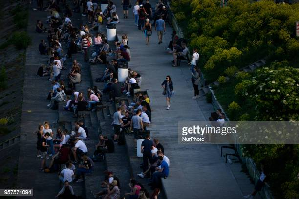 People are seen enjoying the warm Spring weather on the banks of the Vistula river in Warsaw Poland on May 11 2018 The local authorities have lifted...