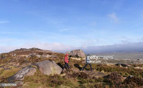 People are seen enjoying their daily exercise as they walk at the Roaches in the Peak District on November 06, 2020 in Leek, Staffordshire .