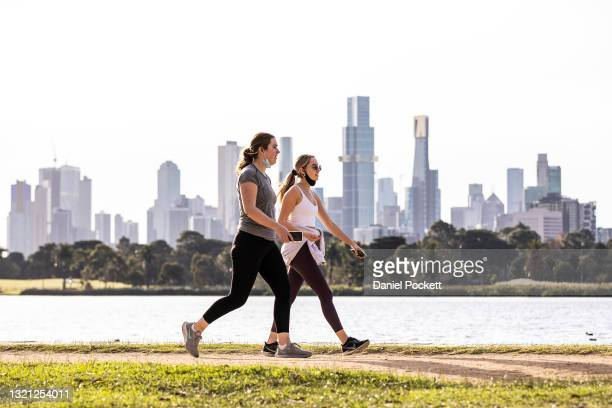 People are seen exercising at Albert Park Lake on June 02, 2021 in Melbourne, Australia. Lockdown restrictions have been extended for another seven...