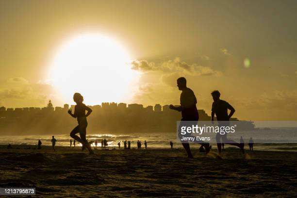 People are seen exercising at Bondi Beach on March 21 2020 in Sydney Australia The NSW Government has announced it will close Bondi Beach in a bid to...