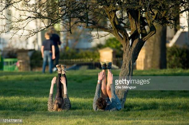 People are seen exercising in Primrose Hill on March 25, 2020 in London, United Kingdom. British Prime Minister, Boris Johnson, announced strict...
