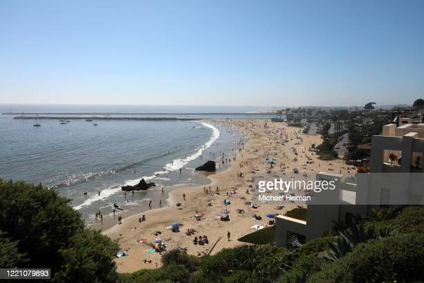 People are seen gathering on the Corona del Mar State Beach on April 25 2020 in Newport Beach California Southern California is expecting summer like...