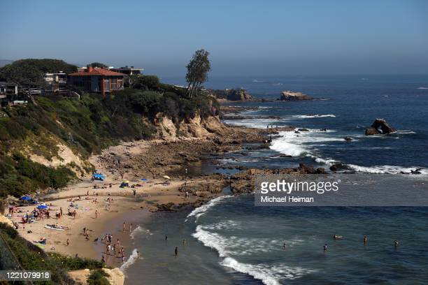 People are seen gathering on the Little Corona del Mar Beach on April 25 2020 in Newport Beach California Southern California is expecting summer...
