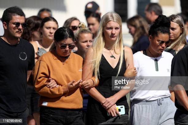 People are seen grieving and comforting each other outside the Te Manuka Tutahi Marae on December 10 2019 in Whakatane New Zealand Five people are...