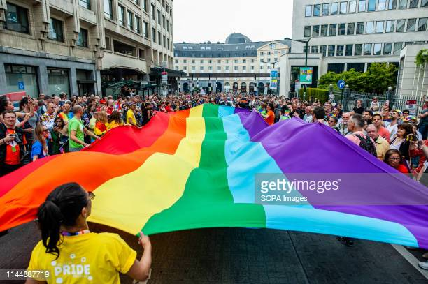 People are seen holding a big rainbow flag during the parade. The 24th Belgian Pride parade took place in Brussels and it kicked off at 13:45 pm from...