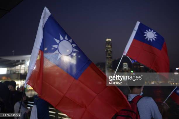 People are seen holding up a Taiwan National Flag in Hong Kong on October 10 Today Taiwan Celebrates it National Day