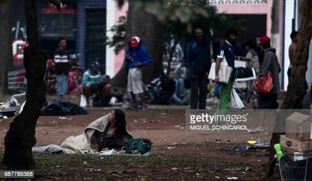 People are seen idle at Princesa Isabel square in the neighborhood known as 'Cracolandia' in Sao Paulo Brazil on May 24 2017 Police in Brazil's...