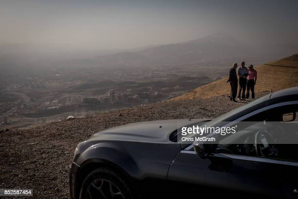 People are seen in a park overlooking Sulaymaniyah City ahead of the upcoming referendum for independence of Kurdistan on September 23 2017 in...