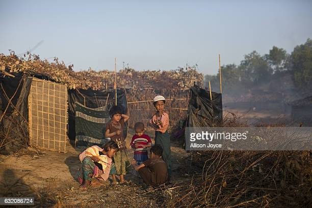 People are seen in the Balu Kali Rohingya refugee camp on January 19 2017 in Coxs Bazar Bangladesh More than 65000 Rohingya Muslims have fled to...